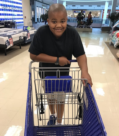 Xander Driving a Shopping Cart