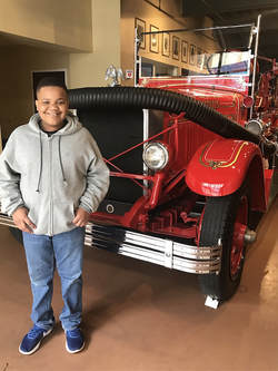 4 Reasons We Homeschool Year Round-Xander at Fire Museum