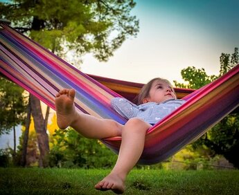Lazy Dilly Day - little girl in hammock